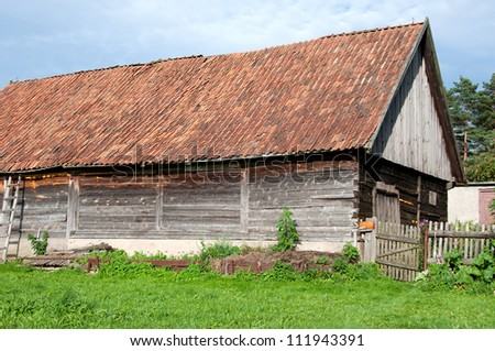old farm house covered with tiles - stock photo
