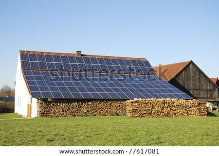 Old farm house with innovative photovoltaic installation - stock photo