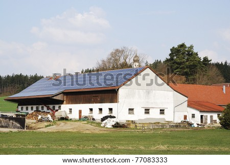 Old farm house with innovative photovoltaic system - stock photo