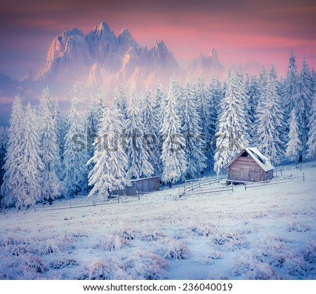 Old farm in the mountains. Colorful winter morning. Retro style. - stock photo