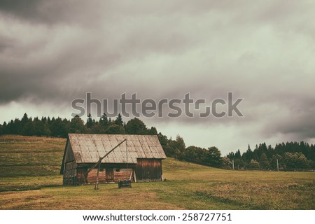 Old farm in transylvania - stock photo