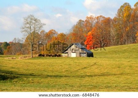 Old farm land with barn fall colors and beautiful blue sky
