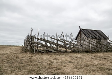 Old farmhouse in the field. Island of Gotland, Sweden. - stock photo