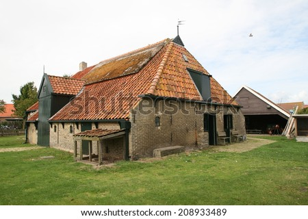 Old farmhouse on Ameland, Netherlands. - stock photo