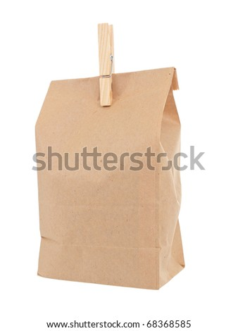Old-fashied lunch bag with wooden clothes pin on white background - stock photo