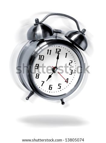 Old-fashion alarm clock ringing, shaking and jumping like crazy - stock photo