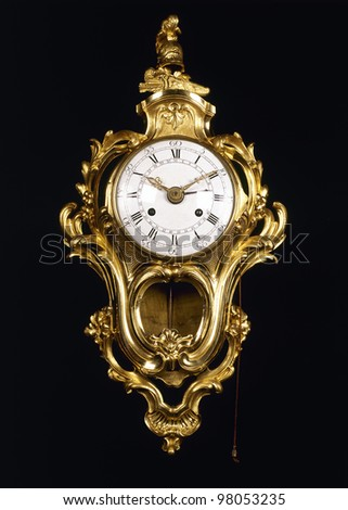 Old-fashion golden clock with pendulum on black - stock photo