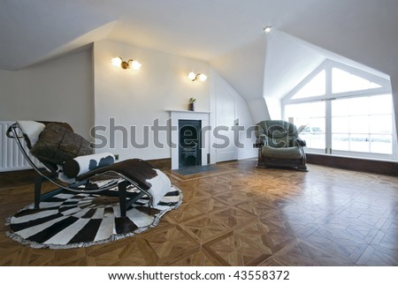 old fashion living area with designer deck chair made of cow fur, green leather armchair and fireplace - stock photo