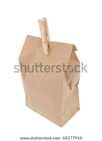 Old-fashion lunch bag with wooden clothes pin 2 on white background