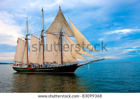 Old Fashion Sail Boat near Harbor - stock photo