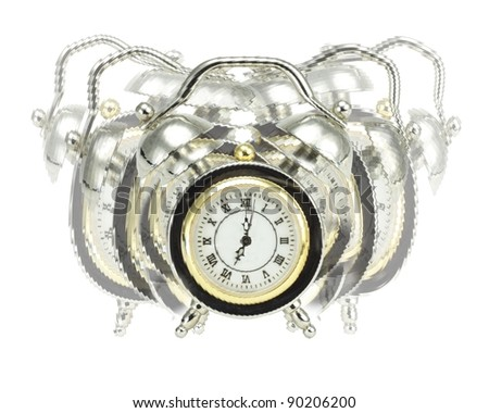 Old-fashioned alarm clock getting off like crazy at seven o'clock in the morning to start a new day - stock photo