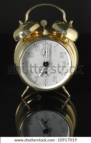 Old fashioned alarm clock on a blue background.