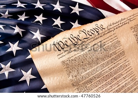 Old fashioned American Constitution with USA  Flag. - stock photo