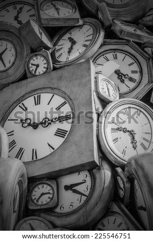 old fashioned and vintage clocks in black and white - stock photo