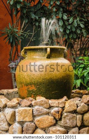 Old-fashioned and vintage fountain. - stock photo