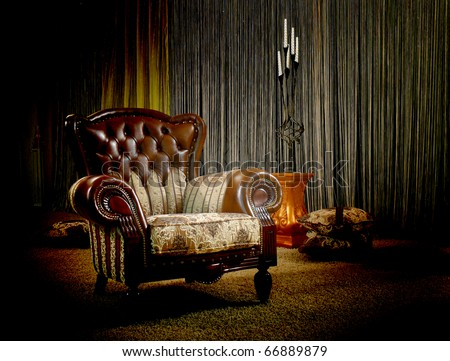 Old-fashioned armchair in gloomy light - stock photo