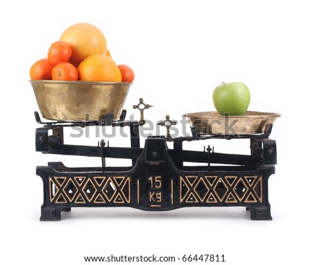 Old-fashioned balance scale with citrus and green apple, isolated  on white background - stock photo