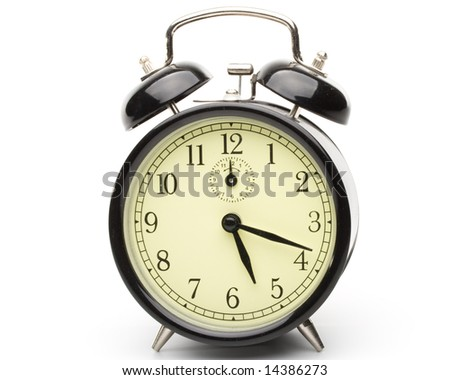 Old-fashioned black alarm clock  on a white background - stock photo