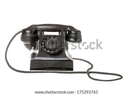 Old-fashioned black rotary telephone instrument with its handset on the cradle on a white background with a reflection and copyspace - stock photo
