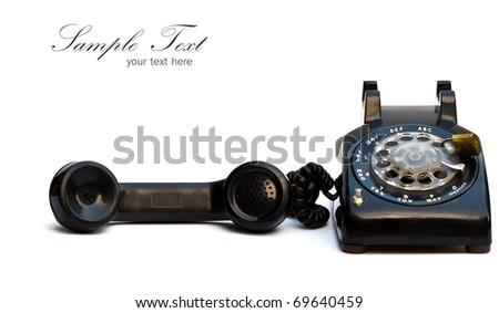 Old-fashioned black telephone on white background. - stock photo