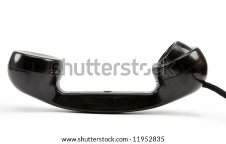 Old-fashioned black telephone receiver with cord isolated on white. Clipping path incl.