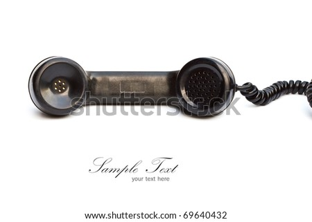 Old-fashioned black telephone receiver with cord on white background. - stock photo