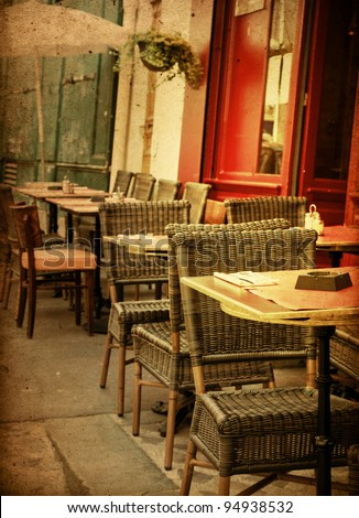 old-fashioned Cafe terrace with tables and chairs,paris France - stock photo