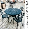 Old fashioned cafe terrace with wrought iron tables and chair furniture on the outdoor bistro for Pleasant dining area experience - stock photo