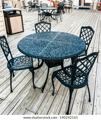 Wrought iron furniture stock images royalty free images for Wrought iron cafe chairs