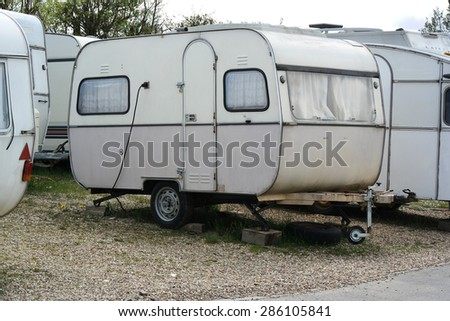 Old-fashioned caravans on a travel trailer campground in Belgium - stock photo