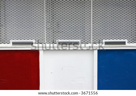 Old-fashioned carnival ticket booth with three ticket windows in red, white, and blue - stock photo