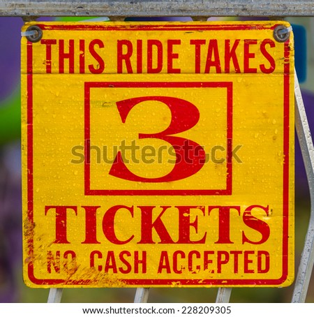 Old fashioned carnival ticket ride in the rain - stock photo