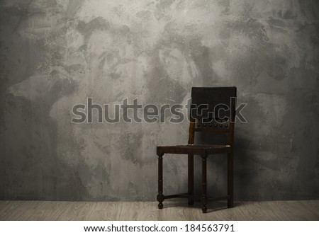 Old fashioned chair on wooden floor  - stock photo