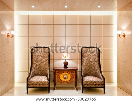 old fashioned chairs and side table at the hotel lobby - stock photo