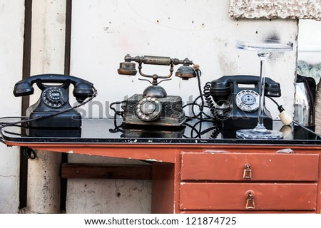 old-fashioned classic telephone on the table - stock photo