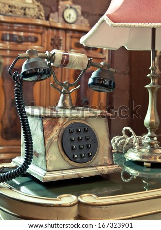 old-fashioned classic vintage telephone on the table - stock photo
