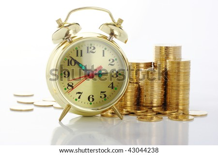 Old-fashioned clock dial and golden coins, time is money concept, isolated over white