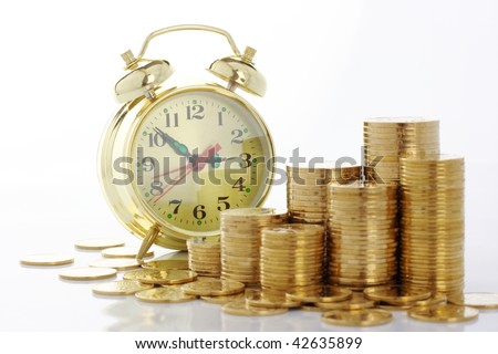 Old-fashioned clock dial on golden coins background, time is money concept, isolated over white - stock photo
