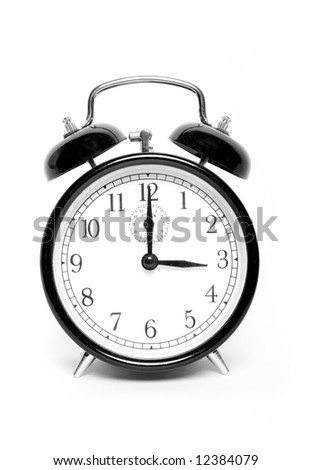 Old fashioned clock showing three o'clock - stock photo