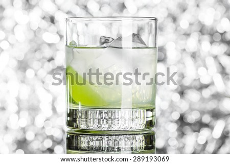 Old fashioned cocktail on the bokeh background. Toned image. Black and white style. - stock photo