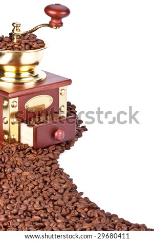 Old-fashioned coffee grinder and coffee beans on a white background