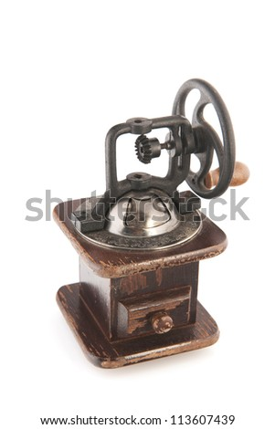 Old-fashioned coffee grinder with wheel
