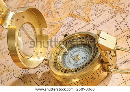 old-fashioned compass on a background an old map - stock photo
