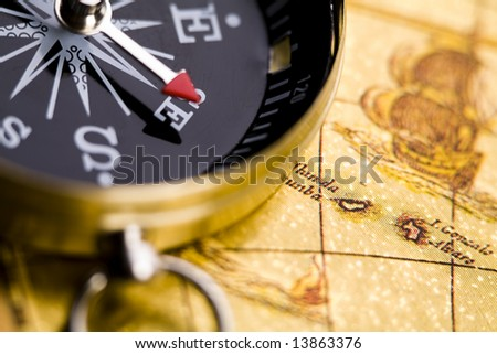 Old-fashioned compass on map - stock photo