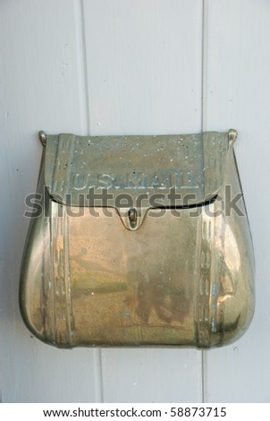 Old fashioned copper mail box - stock photo