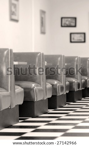old fashioned diner with booths and checkered tile floor - stock photo
