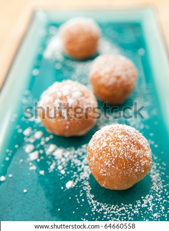 Old-Fashioned Doughnuts Sprinkled with Powder Sugar - stock photo