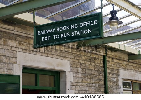 Old-fashioned English railway station;  detail of vintage railway station with glass roof and gas lamp  - stock photo