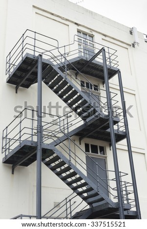 Old Fashioned External Stairs Fire Escape Painted Grey On The Rear Of An  Old Style White