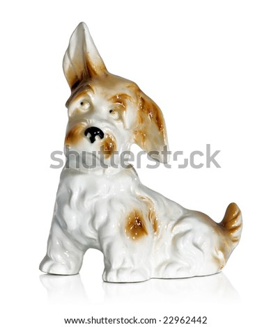 Old-fashioned figurine of a dog isolated on white - stock photo